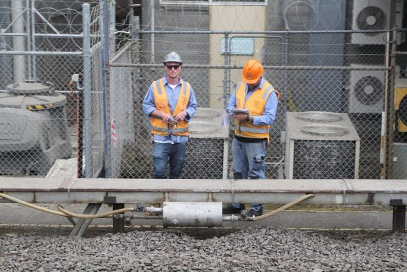 Metro Trains staff inspect signalling equipment at North Melbourne