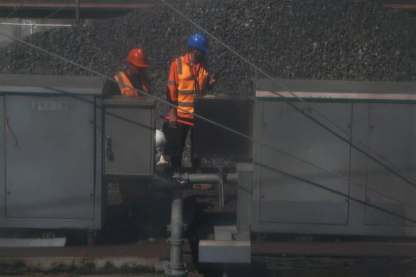 Metro staff inspect signalling equipment at Southern Cross Station