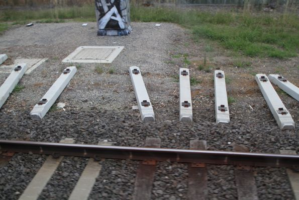 Concrete sleepers awaiting installation between Bayswater and Boronia
