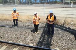 Metro Trains staff inspect the tracks at Richmond Junction