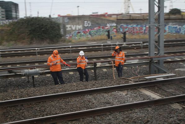 Metro Trains staff lineside at North Melbourne