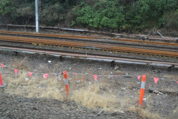 Fresh rails between the tracks at the down end of North Melbourne station