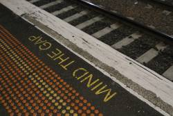 Gouged down concrete platform edge at Newport station