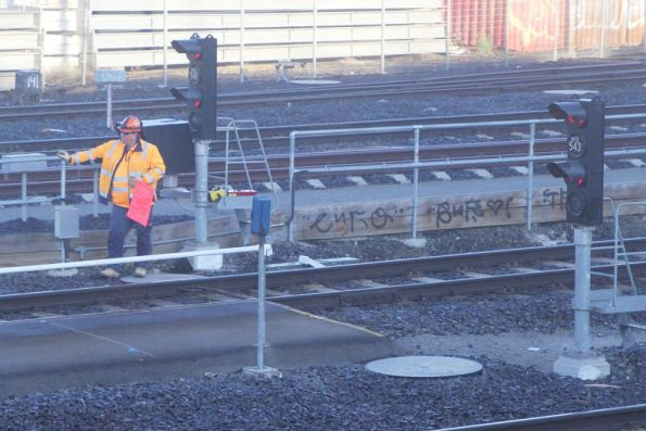 Flagman on the goods lines at Melbourne Yard, due to overhead repair works