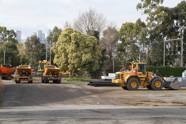Front end loader and hi-rail dump trucks access the rail corridor at Showgrounds