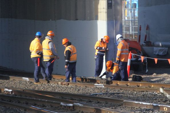Metro Trains staff working on the track during morning peak at North Melbourne