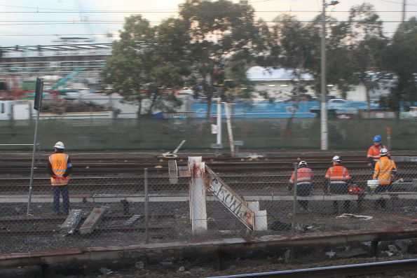 Metro Trains staff work on the Upfield line tracks at Macaulay