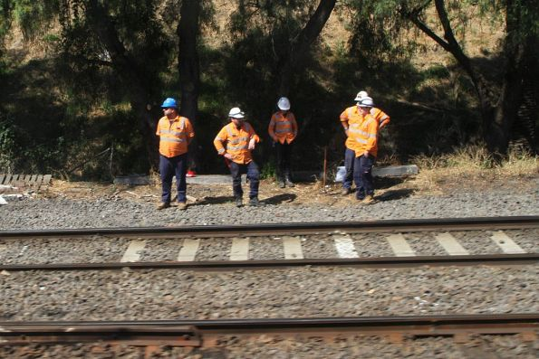 Track gang wait for passing trains at Moonee Ponds Junction