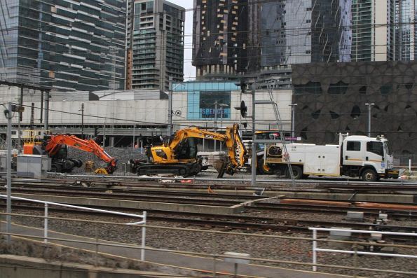 Metro Trains hi-rail truck and excavators at the north end of Southern Cross Station