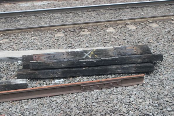 Worn out timber sleepers sitting beside the tracks following placement at Flinders Street