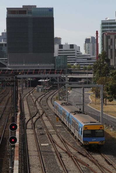 3-car Alstom Comeng 340M departs Melbourne Yard with a driver training run