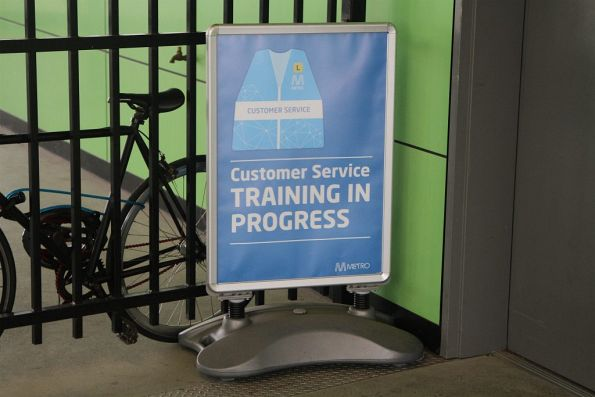 'Customer service training in progress' poster at West Footscray station