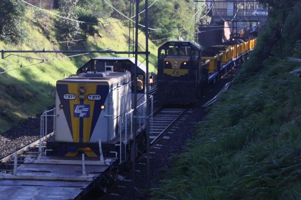 Two T classes at South Yarra - T377 stabled on a sleeper train, opposite T378 on the spoil train