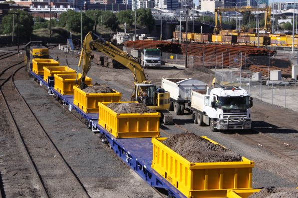 A second excavator at work at the other end of the train