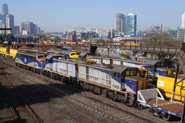 B76, T376 and T373 stabled on the Metro concrete sleeper / rail train