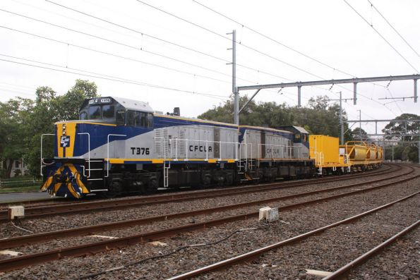 T376 and T373 stabled at the down end of a suburban ballast train at Caulfield