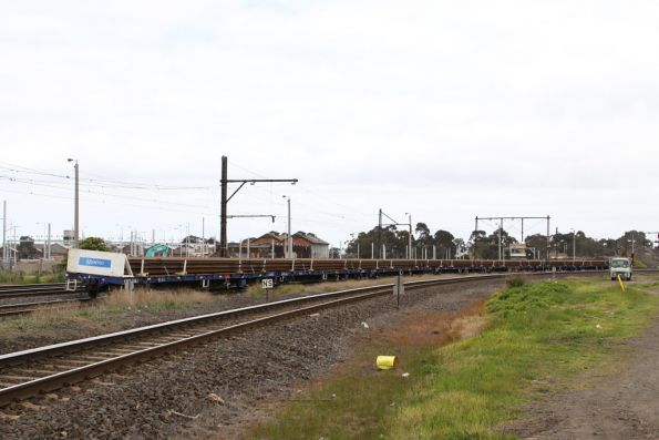 Loaded rail flats on the broad gauge goods line at Newport, waiting for the locos to return