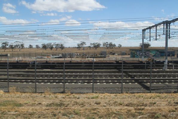 Two rakes of flat wagons stabled in the yard at Calder Park