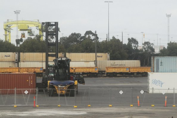CQXY container wagons loaded with Metro Trains spoil containers stabled at North Dynon