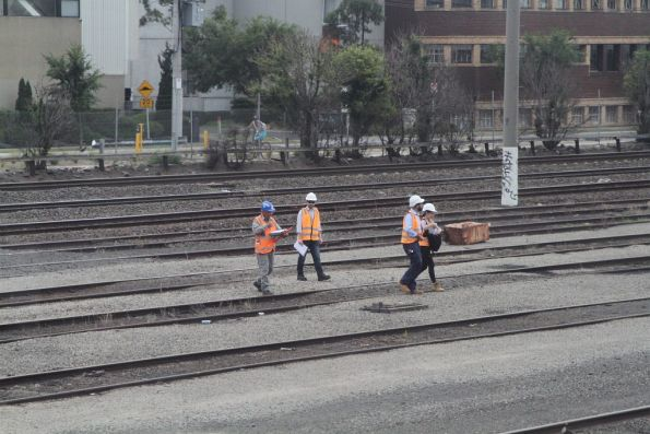 Metro Trains staff inspect the future site of the West Footscray turnback siding