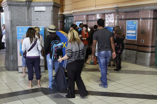 Queue of passengers for the Myki CVMs at the main entrance of Flinders Street Station