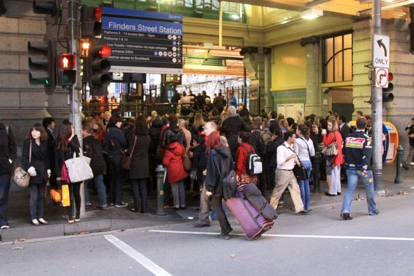 Afternoon queues to enter Flinders Street Station banking up onto Elizabeth Street