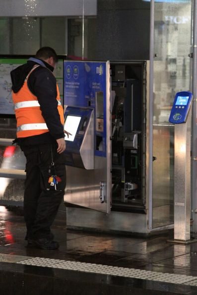 Bytecraft technician works on a Myki CVM at a CBD tram stop