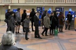Afternoon peak queues to top up using the two Myki CVMs at Flagstaff station