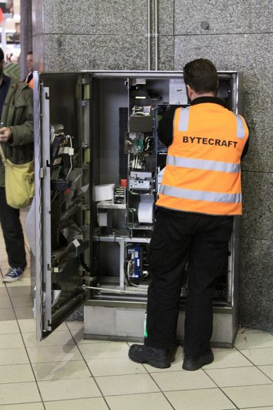Bytecraft technician working on a faulty Myki CVM at Flinders Street Station