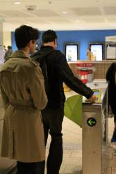 Commuters try to touch on at Melbourne Central Station via a faulty Myki barrier
