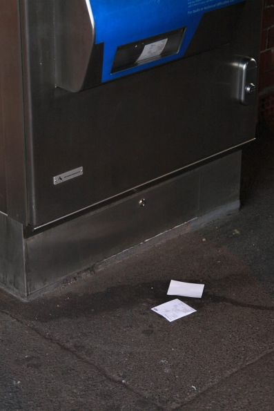 More forgotten receipts litter the ground around a Myki machine
