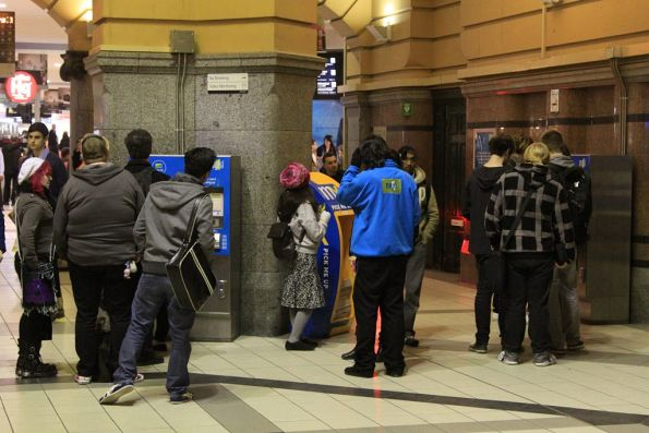 Queue of passengers wanting to top up their Myki at Flinders Street Station