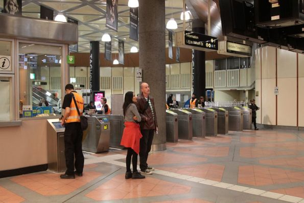Bytecraft technician trying to repair faulty Myki barriers at Flagstaff station