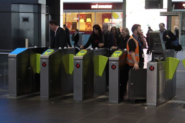 Technician fixing broken Myki gates at Southern Cross Station