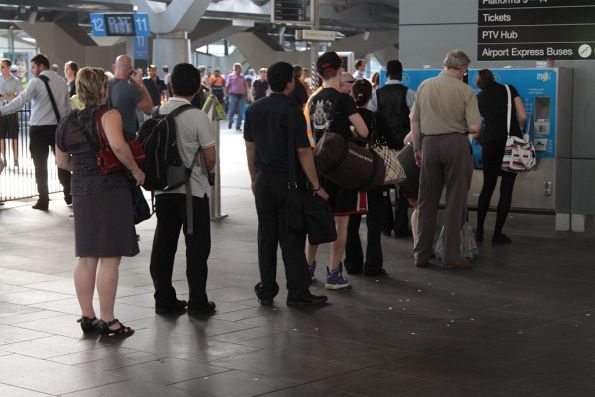 Another afternoon peak, another queue for Myki topups at the machine