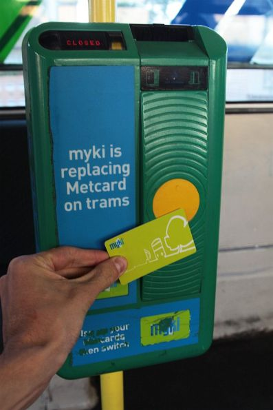 I put my MYKI branded card onto the thingy with the big MYKI text, don't I?