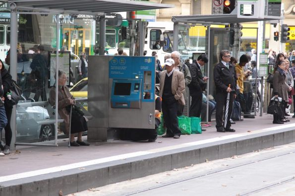 Myki ticket machine under repair at a tram stop