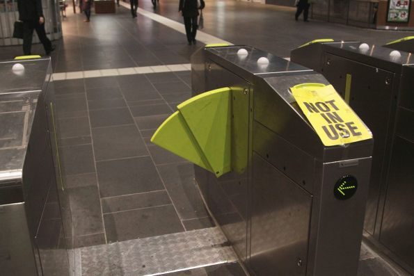 Myki gates at Southern Cross, with one of the paddles stuck inside the mechanism