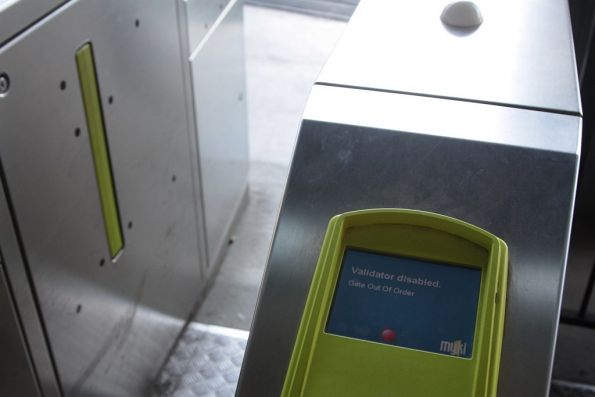 Myki gate with the paddles stuck open, the reader displaying a 'gate out of order' message