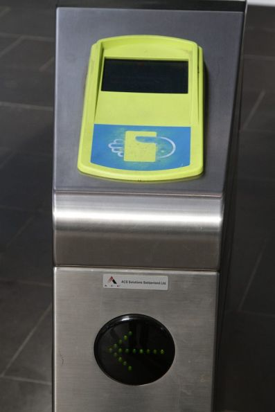 Myki gate with a defective FPD, but the green arrow incorrectly displaying the 'proceed' arrow