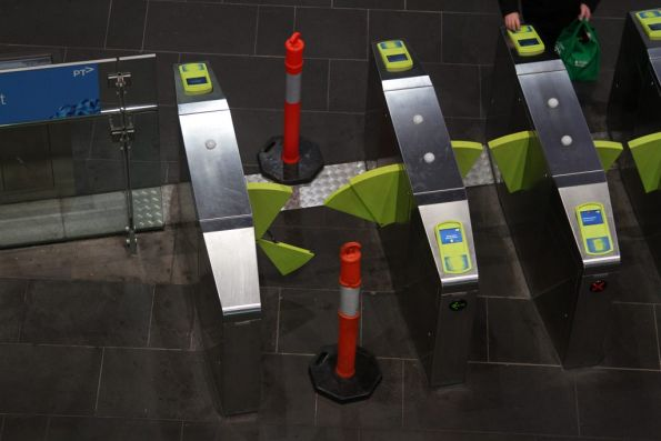Broken barrier paddles on a set of Myki gates at Southern Cross