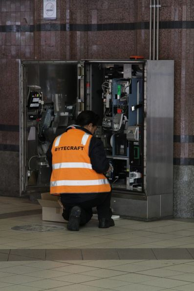 Bytecraft technician services a Myki machine at Flinders Street Station