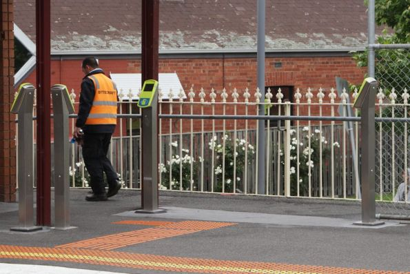 Bytecraft technician cleaning Myki readers at a suburban railway station