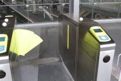 Defective set of myki wide gates - one of the paddles stuck inside the mechanism