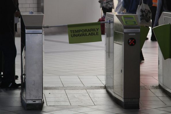 'Temporarily unavailable' sign blocks access to a defective set of myki gates at Flinders Street Station