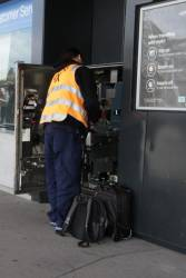 Vix technician works on a faulty myki machine at South Morang