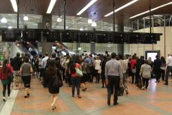 Queues form behind the underperforming myki gates at Flagstaff station