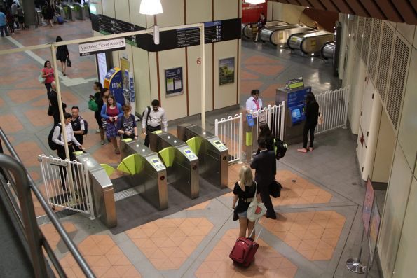 Myki gates go on the fritz at Flagstaff station, as the barrier staff try to fix them