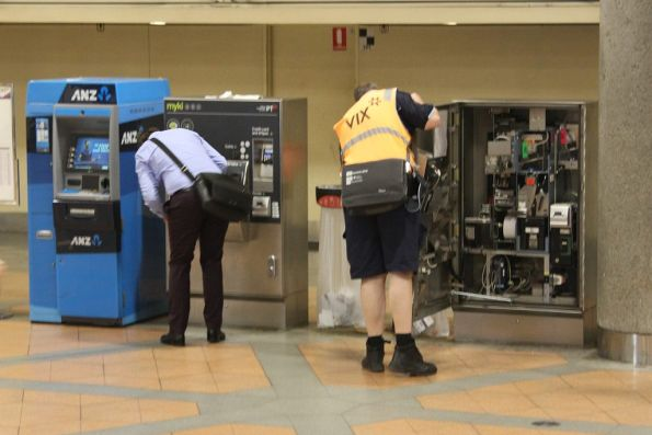 Vix technician works on a defective myki machine at Flagstaff station