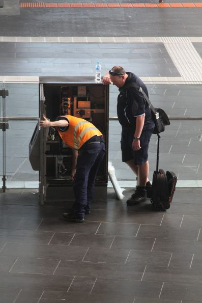 Vix technician works on a defective myki machine at Southern Cross Station